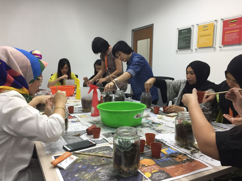 EcoKnights Engages With Guardian Staff in Terrarium Workshop